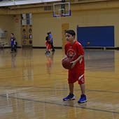 Elks Hoop Shoot: Young boy at the free throw line.