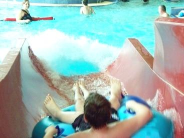 Boy Riding Water Slide