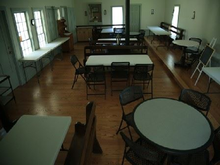 Overhead View of the Tables Inside of the Friends Meeting House