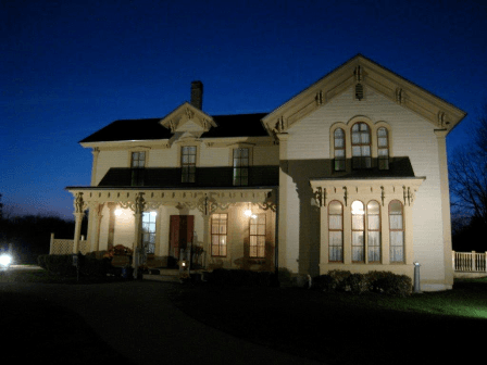 Exterior of the Alexander Blue House at Night Illuminated