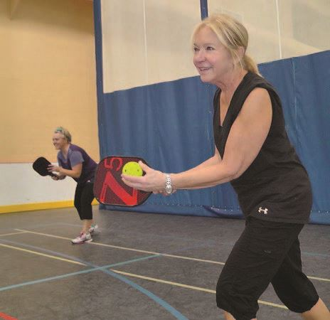 Two People Playing Pickleball
